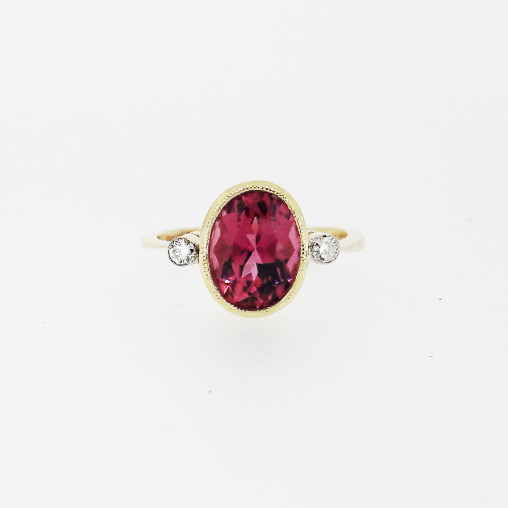 Tourmaline and diamond three stone ring